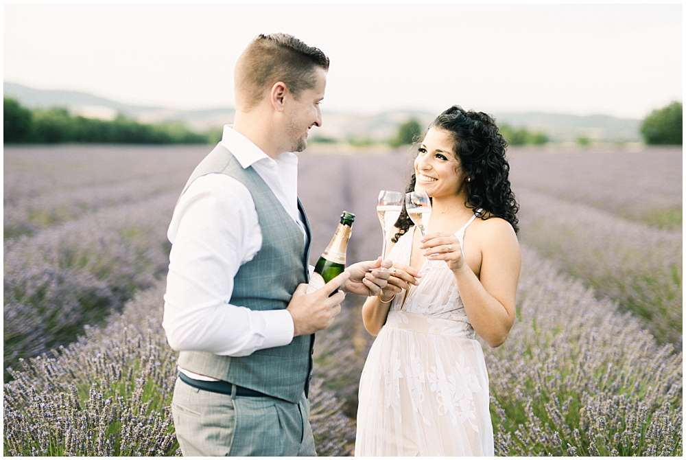 engagement session in lavander of provence with champagne